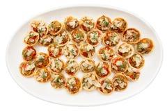 在板材的菜开胃菜,隔绝在白色 库存图片
