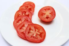 在板材的蕃茄切片 库存例证