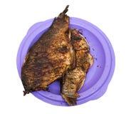在板材的被烘烤的鱼 免版税库存图片