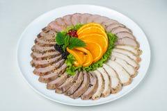 在板材的食物在白色背景 免版税图库摄影