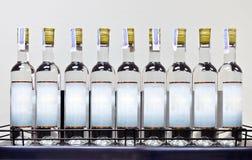 在架子的白色兰姆酒 免版税库存照片