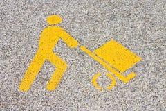 在柏油路的装载的物品都市标志-被定调子的图象 免版税库存图片