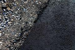 在柏油路边缘的石头 免版税图库摄影