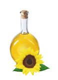 在查出的瓶和向日葵的油 免版税库存照片