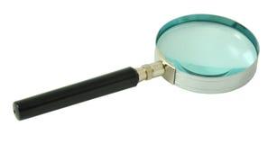 在查出的白色的放大镜 免版税图库摄影