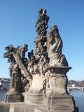 在查尔斯桥梁的雕象 免版税库存图片