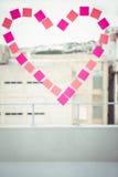 在柱子的心脏在窗口 图库摄影