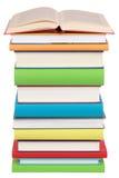 在栈的被开张的书书 免版税库存图片