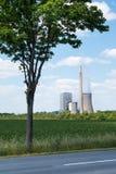在树后的能源厂 免版税库存照片