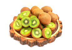在树木材的猕猴桃削减了在白色隔绝的委员会 免版税库存照片