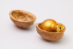 在核桃壳的圣诞节装饰  免版税库存照片