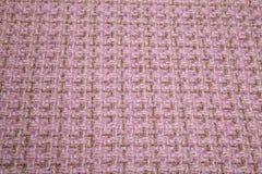 在格子花呢披肩的淡粉红的温暖的布料 免版税图库摄影