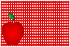 在格子花呢披肩红色的苹果 免版税库存照片
