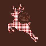在格子花呢披肩织品的驯鹿圣诞节 库存图片
