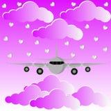 在桃红色云彩和天空爱Backgrouund的平面飞行 皇族释放例证