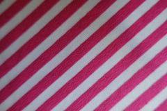 在桃红色和白色的聚酯与对角条纹 库存照片