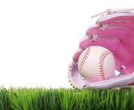 在桃红色女性手套的棒球在绿草,被隔绝 免版税库存照片