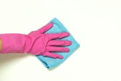 在桃红色橡胶的一只手 免版税库存图片