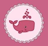在桃红色的逗人喜爱的小鲸鱼 免版税库存图片