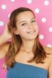 在桃红色的青少年的女孩画象 免版税库存图片