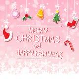 在桃红色背景的各种各样的垂悬的圣诞节装饰品与雪花 库存照片