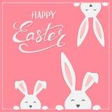 在桃红色背景的复活节兔子 库存照片