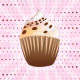 在桃红色背景的巧克力杯形蛋糕 免版税库存照片