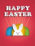 在桃红色背景的愉快的复活节兔子兔宝宝 库存图片