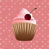 在桃红色背景的杯形蛋糕 库存照片