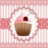 在桃红色背景的杯形蛋糕 库存图片