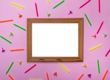 在桃红色背景的空的木制框架 免版税图库摄影