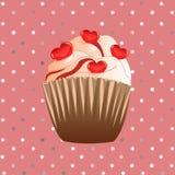 在桃红色背景的糖果杯形蛋糕 库存照片