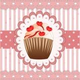在桃红色背景的糖果杯形蛋糕 库存图片