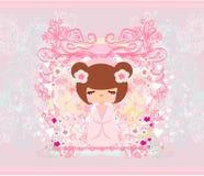 在桃红色背景的Kokeshi玩偶 免版税库存图片
