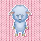 在桃红色被编织的背景的羊羔 免版税图库摄影