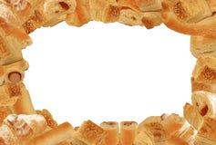 在框架酥皮点心上添面包 库存照片