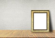 在桌上把放的画框 免版税库存图片