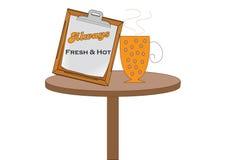 在桌上的咖啡杯 免版税库存图片