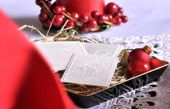 在桌上的圣诞节白色薄酥饼 Oplatek 图库摄影