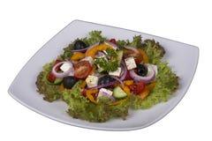 在桌上的新鲜蔬菜希腊沙拉 免版税图库摄影