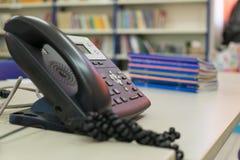 在桌上的电话 免版税库存照片