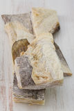 在桌上的盐味的鳕 免版税库存照片