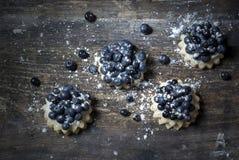 在桌上的蓝莓点心 免版税库存照片