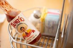 在桌上的Tapatio辣酱 免版税库存图片