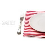 在桌布的空的空白牌照与叉子 免版税库存图片