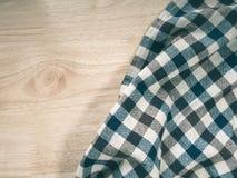 在桌,您的设计的拷贝空间上的纺织品衣物 免版税图库摄影