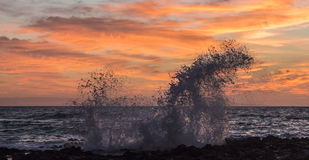 在桑迪的日出飞溅 库存照片