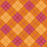 在桔子和粉红色的偏压格子花呢披肩 免版税图库摄影