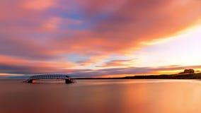 在桥梁的日出对无处 免版税库存图片