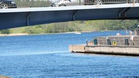 在桥梁的汽车在运河,青苔,挪威 影视素材